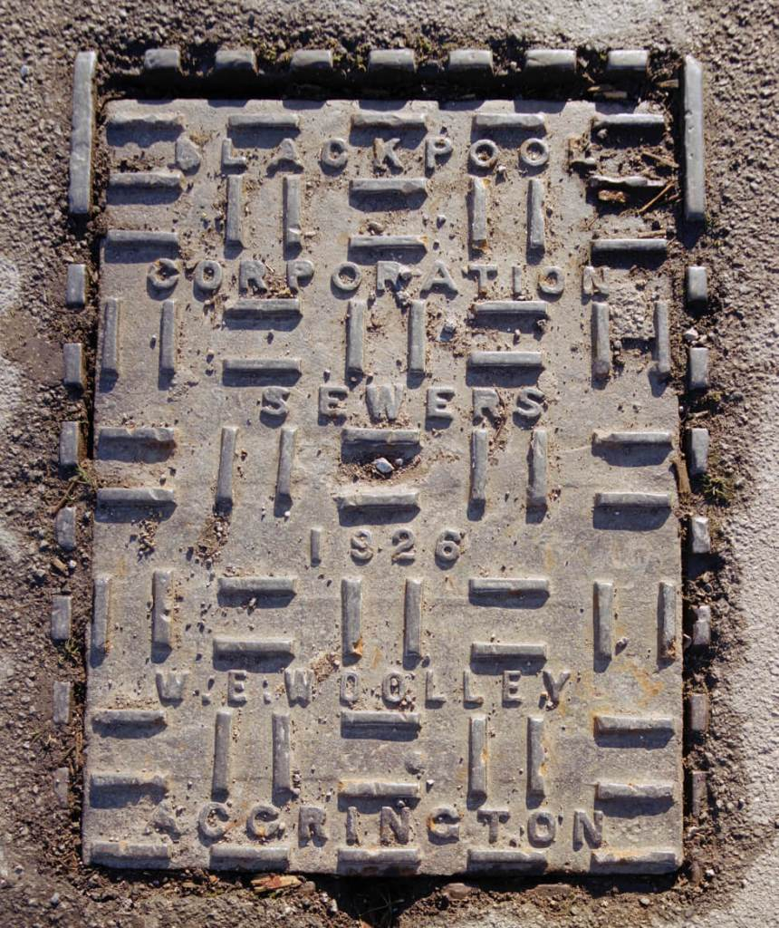 Manhole cover with text ' Blackpool corporation sewers, 1926 W. E. Woolley, Accrington'