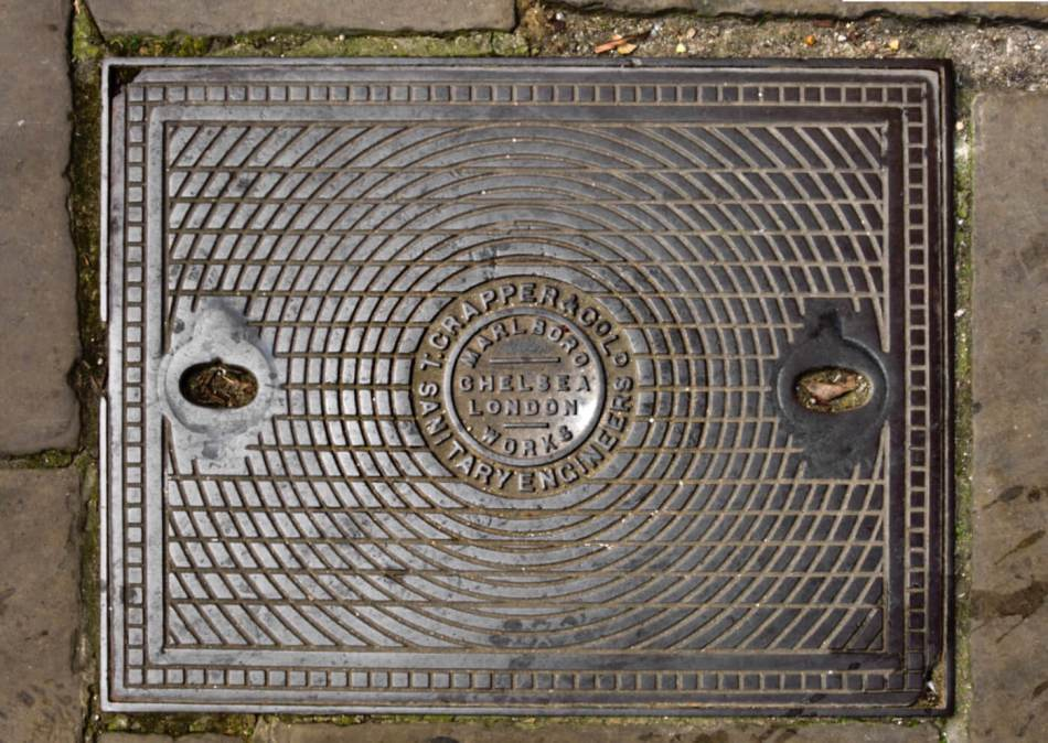 Manhole cover with 'T Crapper & Co Ld, Sanitary engineers' in centre.