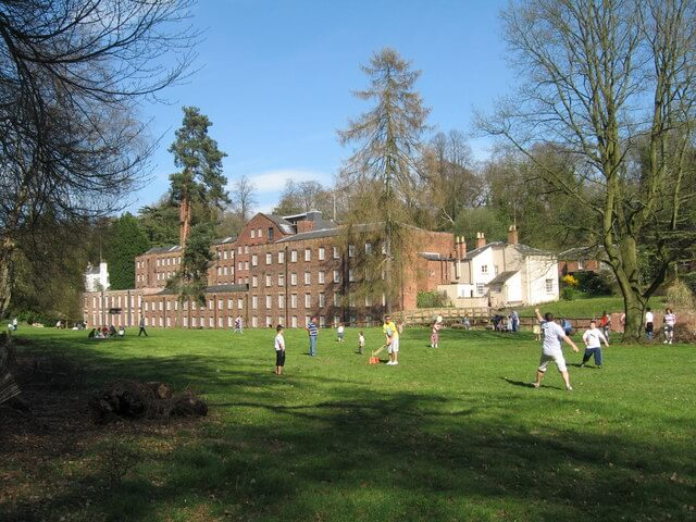 People play rounders outside Quarry Bank Mill