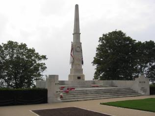 Sited high on The Cliffs overlooking the Thames Estuary Lutyens' original design was a cenotaph surmounted by an urn, but this was changed to a simple 11 metre high obelisk with a painted stone Union Flag and a White Ensign, one of six obelisks he designed. It was unveiled 27 November 1921 in front of a large crowd with D Company 6th Essex Regiment forming a guard of honour. A memorial tablet bearing the names of the 1,338 who died was erected at Prittlewell Priory (now part of Southend Museums). Lutyens also designed the garden in front of the memorial. White stone chippings spelling out 'LEST WE FORGET' have been added on the lawn at a later date. Photo courtesy of Tim Skelton