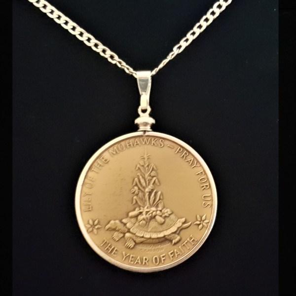 Saint Kateri Medal by Garrison Garrow A Mohawk Artist1.50 in 38.00 x 4.40 mm Coin Edge Sterling Silver Plated Bezel Sterling Silver Chain rev 8+18+5+18=69 REV