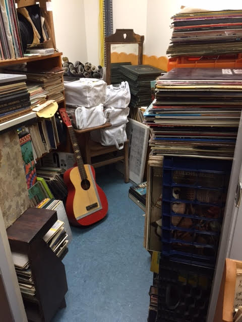Our Music Room Has Record Albums, Books, Sheet Music, Posters, Instruments and Years of Bass Player Magazines