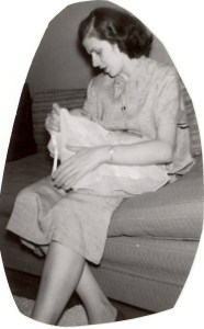 Mary (Helbling) McMurray holding their first child, 1954.