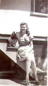 "Mary T. Helbling and ""Honeychow,"" the family's beloved cocker spaniel, c early 1940s."