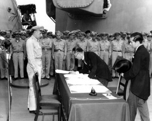 """Shigemitsu-signs-surrender"" by Army Signal Corps - Naval Historical Center Photo # SC 213700. Licensed under Public domain via Wikimedia Commons. 02 Sep 1945 aboard USS Missouri."