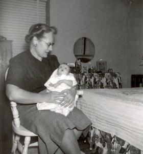 Edith Roberts Luck with her first granddaughter in 1954.