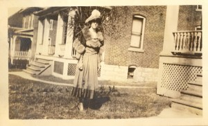 April, 1918. Possibly Dorothy (Aiken) Lee in front of their home at 1038 Grand View Place, St. Louis, Missouri.
