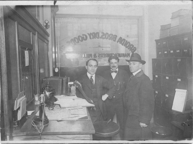 Samuel A. (Karklinsky) Broida (1887-1973) with two unknown men in Broida Brothers Dry Goods, St. Louis, Missouri. Taken between 1910-1929.