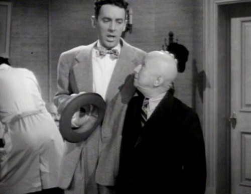 "Buster Brodie/Max Broida in Joe McDoakes short, ""So You Want to Keep Your Hair,"" a 1946 Warner Brothers Production."