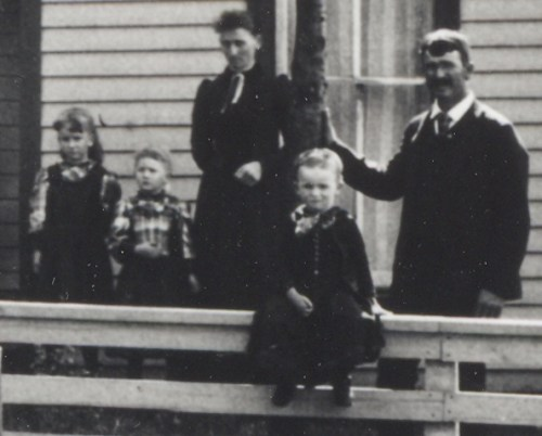Jason Lee Roberts Family, 1892, Jasper County, Iowa. From left: Orphan B. Roberts, Oca S. Roberts, Julia (French) Roberts, Guy L. Roberts sitting on fence, and Jason Lee Roberts.