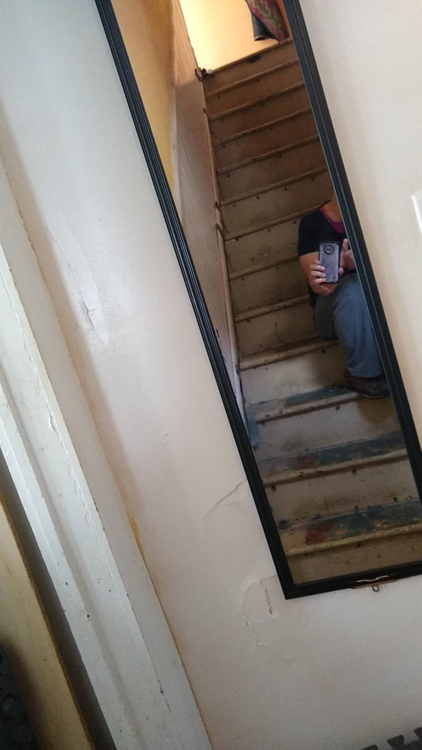 Mirror at the foot of stairs