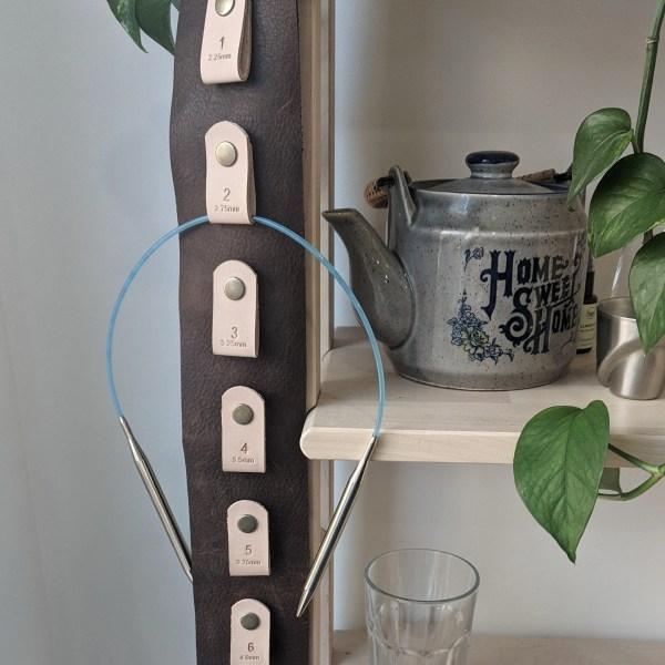 Close up knitting needle wall hanger