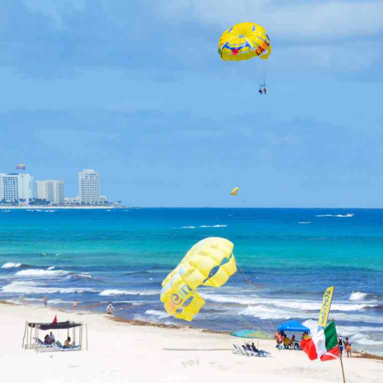 Go Parasailing in Cancun Adventurers Guide to 1 Week in Tulum - Discover where to eat, where to stay, and adventures such as Scuba diving, snorkeling, kayaking and more! Quintana Roo Mexico #mexico #travel #mexicopacking #wheretostay #hiddengem #vacation #travelguide #adventure #traveltips #northamerica #traveldestinations  #bestbeach #cenote #adventure
