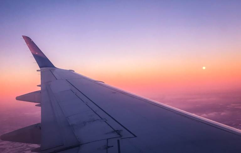 Plane window at sunset The adventure guide to Big Sky Montana in the winter. | herlifeadventures.blog | #traveldestinations #travelideas #northamericatravel #traveltips #usdestinations #travelhacks #travelguide #adventuretravel