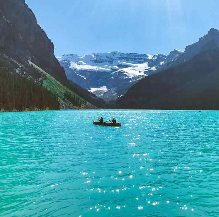 Lake Louise in Banff National Park is located in the Canadian rockies of Alberta. Check out this and more iIncredible photos to inspire your Canada National Park Adventure. Covering Jasper + Banff + Yoho | #traveldestinations #travelideas #northamericatravel #traveltips  #travelhacks #travelguide #adventuretravel #roadtrip #nationalpark #nationalparkroadtrip #alberta #canada #britishcolombia