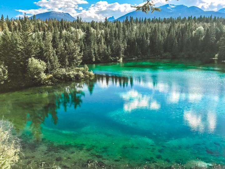 Fourth Lake in Jasper National Park, Alberta Canada and more incredible photos to inspire your Canada National Park Adventure. Covering Jasper + Banff + Yoho | #traveldestinations #travelideas #northamericatravel #traveltips  #travelhacks #travelguide #adventuretravel #roadtrip #nationalpark #nationalparkroadtrip #alberta #canada #britishcolombia
