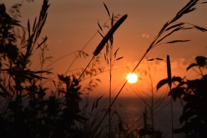 Lake Michigan Sunset in Sleeping Bear Dunes | herlifeadventures.blog | #camping #usdestinations #sleepingbeardunes #nationallakeshore #travelhacks #travelguide #adventuretravel #roadtrip #nationalpark #nationalparkroadtrip #michigantravel #greatlakes #ustravel #summer #bucketlist