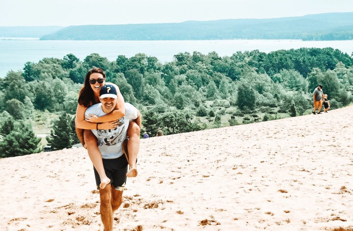 This Sleeping Bear Dunes itinerary covers the best of what to do on the National Lakeshore, how to get there and where to stay. Add this hidden gem to your summer bucket list. | Her Life Adventures | #camping #usdestinations #travelhacks #travelguide #adventuretravel #roadtrip #nationalpark #nationalparkroadtrip #michigantravel #greatlakes #ustravel #summer #bucketlist #sleepingbear #lakemichigan #sanddunes
