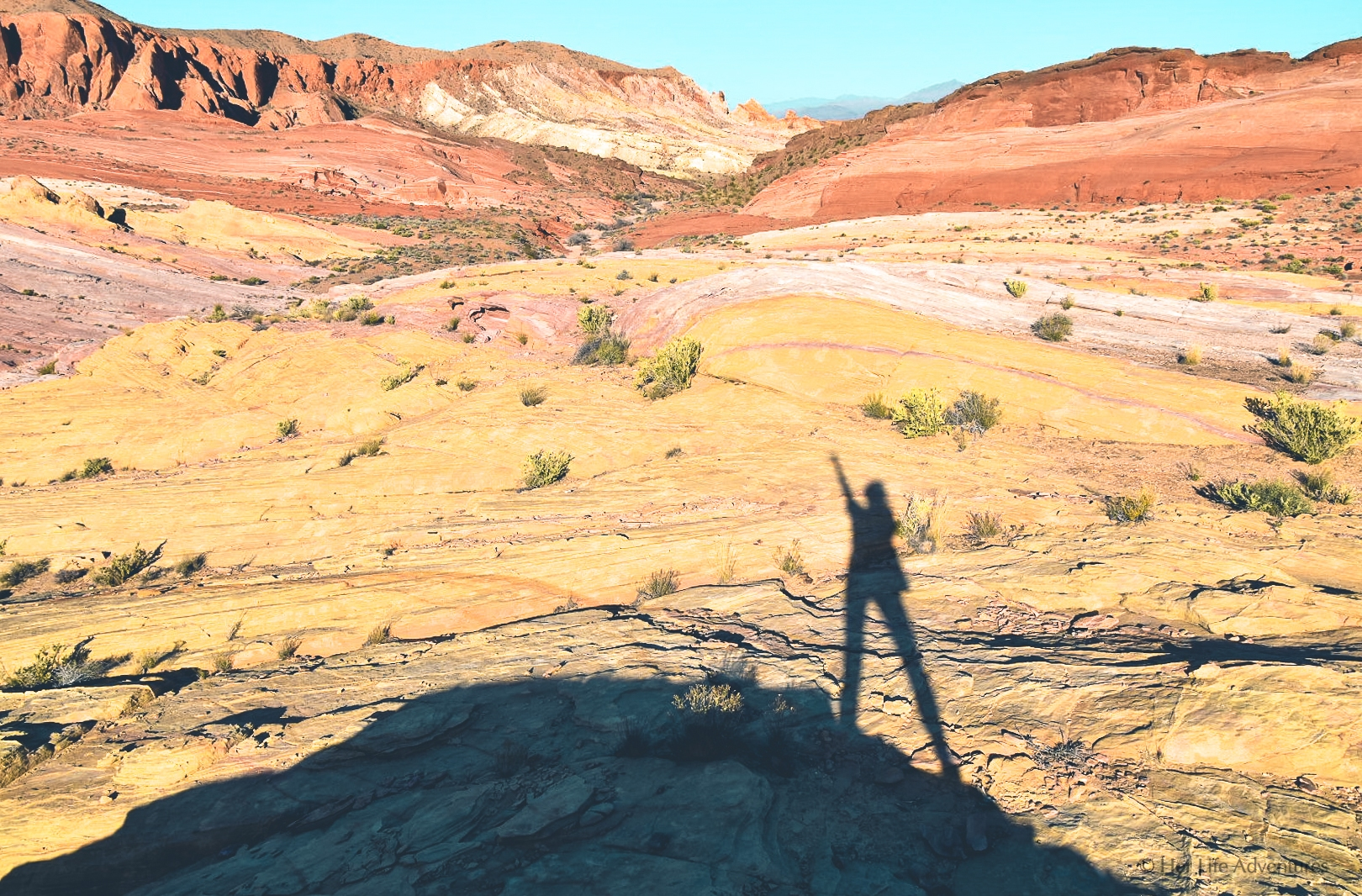 The Wave hike and more in this adventure itinerary will provide you all the information you need for your visit to Valley of Fire State Park in Nevada. The best hikes, what to do, where to stay, tours, how to get there and more! | #nevadatravel #nevadaroadtrip #valleyoffire #statepark #photos #hiking #camping #photography