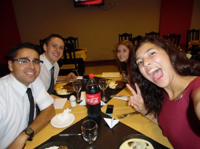 Four missionaries eating lunch
