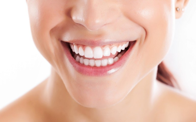 Woman smiling after crown lengthening procedure