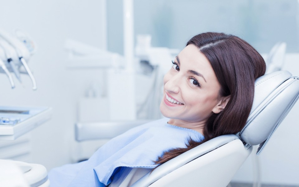 Woman at dentist for an emergency