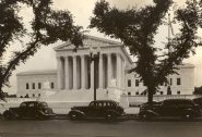 1935 - Vintage cars street Parking at the Supreme Court as it appeared in 1935 complete with vintage automobiles. The East Pediment was on the reverse side to the front steps. Behind MacNeil's East pediment sculptures is the office of the Chief Justice.
