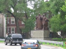 Chicagoans approaching the Monument along Marshall and 24th Avenue Boulevards are greeted by the Jesuit's open hand.