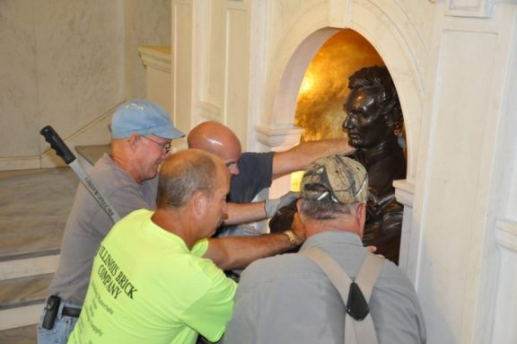 The work crew of masons set the MacNeil's Lincoln bust back into the niche at the Grand Staircase of Lincoln Hall