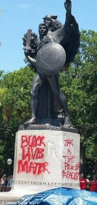 http://i.dailymail.co.uk/i/pix/2015/06/21/21/29D7C09E00000578-3133597-Confederate_monument_vandalized-a-58_1434918039434.jpg
