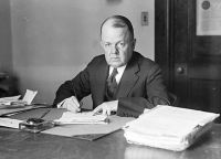 440px-Robert_W,_Woolley_at_his_desk