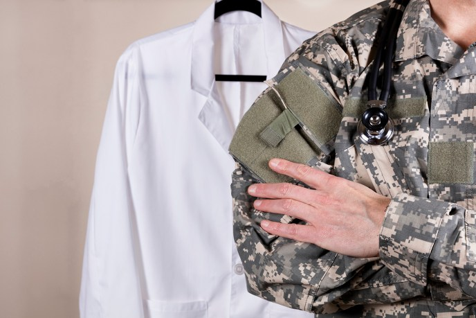 Medical military doctor with white consultation coat