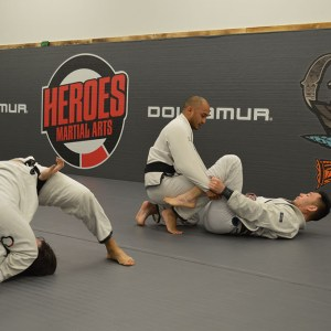 2 pairs of men training Brazilian Jiu Jitsu