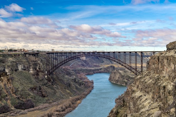 Snake river leads beneath a Twin Falls bridge in the morning