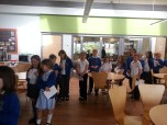 The children eagerly waiting to have their book signed...