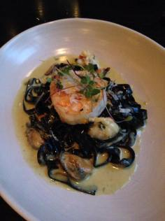 Black tagliatelle with lobster, prawn, mussels, lobster sauce and fresh horseradish | Cento