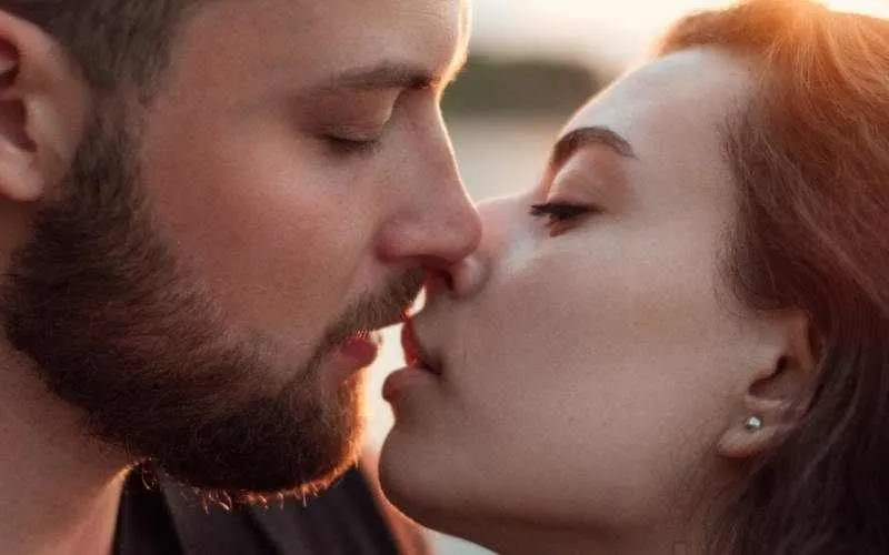 Close up of young man kissing young woman