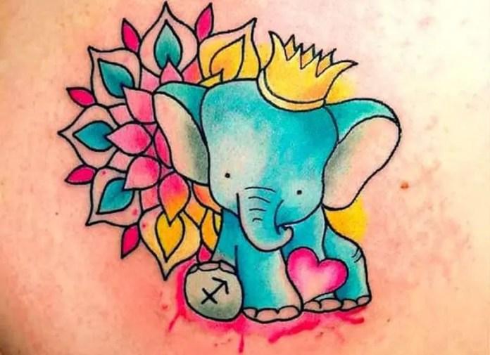 colorful elephant tattoo with sagittarius symbol