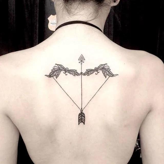 symmetrical back tattoo on woman`s back