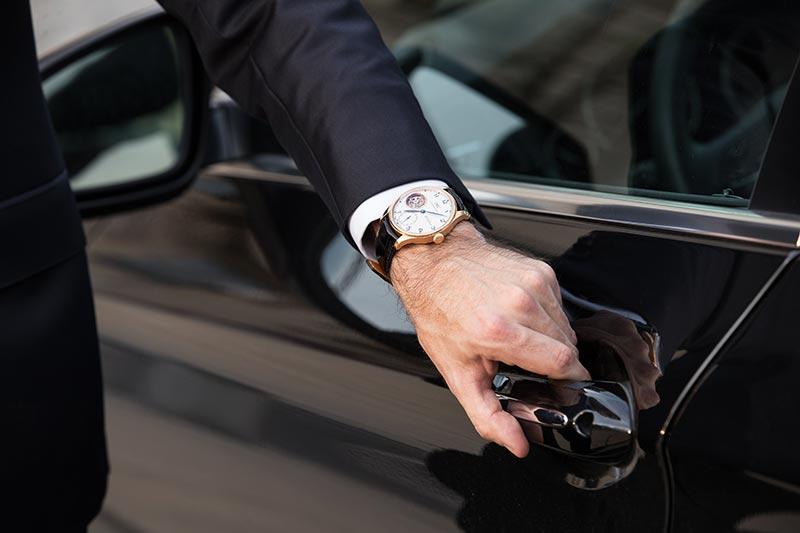 iwc-portugieser-tourbillon-dh-craig-opening-black-bmw-car-door