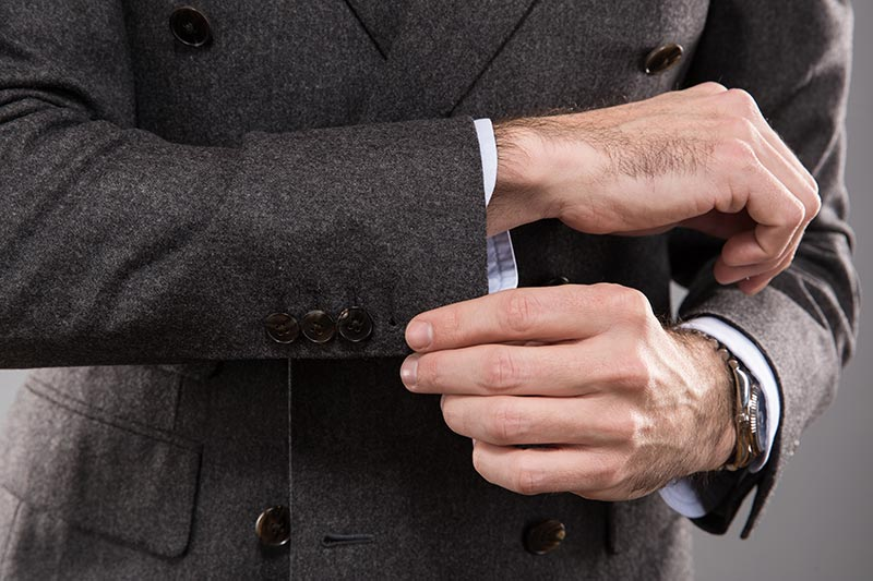 working-button-holes-on-grey-flannel-suit-jacket