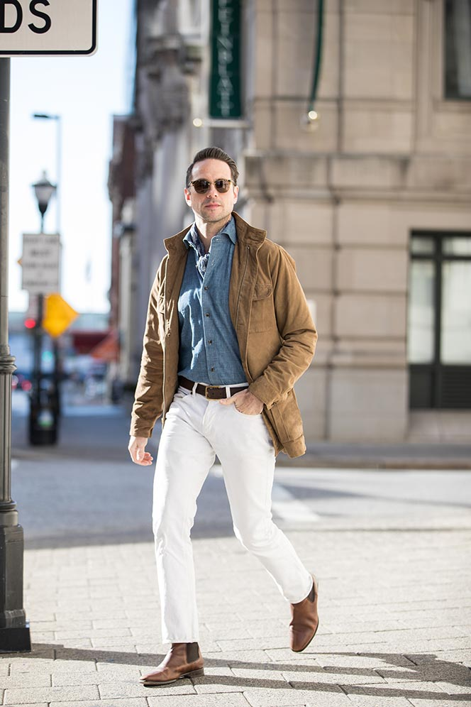 tan-suede-safari-jacket-denim-shirt-white-jeans-brown-leather-chelsea-boots-mens-outfit-idea-spring-style-essentials-1