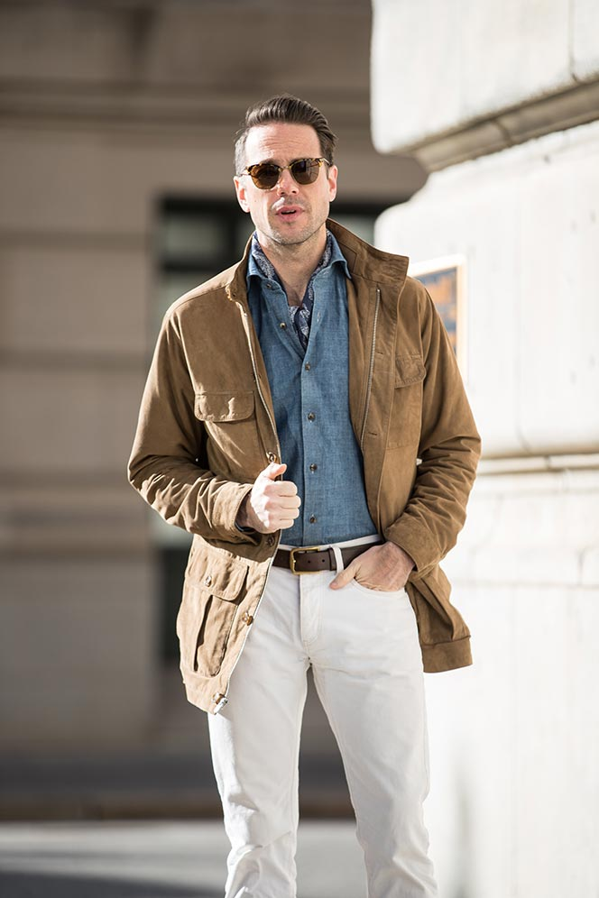 tan-suede-safari-jacket-denim-shirt-white-jeans-brown-leather-chelsea-boots-mens-outfit-idea-spring-style-essentials-peter-millar