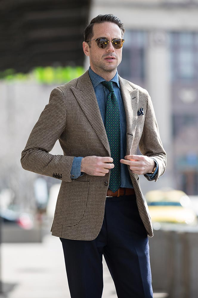 houndstooth-blazer-navy-pants-denim-cutaway-collar-shirt-green-medalion-print-tie-spring-business-casual-outfit-ideas-men-buttoning-suit-jacket