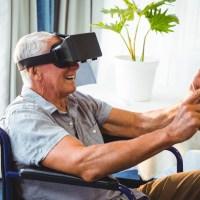 Senior man in a wheelchair using a virtual reality device