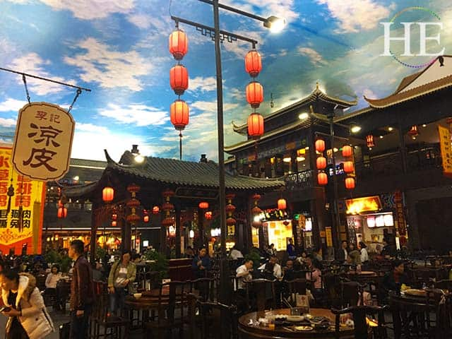 a bustling indoor market below a sky mural ceiling in zhengzhou china