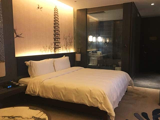 a cozy bedroom at the pullman hotel in kaifeng city china