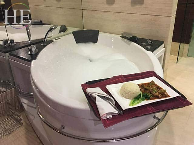 a bubbling jaccuzi tub with room service dinner in luoyang china