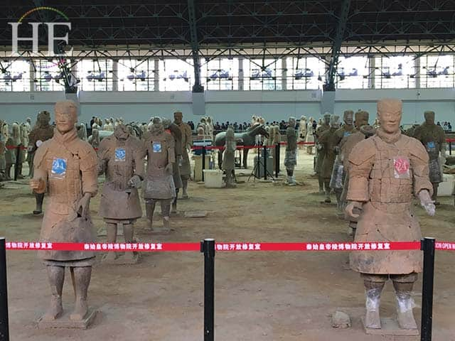 terracotta soldiers being repaired at the terracotta army pits in xi'an china