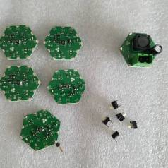 RGB LED modules, a DC-DC power supply and momentary switches for a test array.